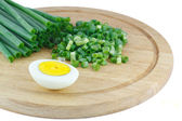 Green onions and half of the eggs — Stock Photo