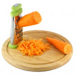 Chopped carrots on a grater — Stock Photo