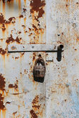 Rust, paint and old lock — Stock Photo