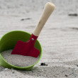 Shovel and bucket on the beach — Stock Photo