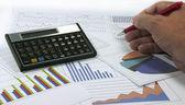 Data graphics analysis with calculator — Stock Photo