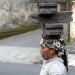 Stock Photo: UBUD - 4 April 2011: woman working in construction carries very