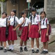 Stock Photo: Girls in Ubud in school uniform