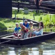 Children playing with boat — Stock Photo