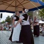 Woman shows original dutch dance in costume — Stock Photo