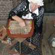 Old woman handicraft - Stock Photo