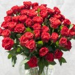 Vase with red roses — Stock Photo