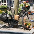 Old bike with flowers and bottles drink — Stock Photo #12079625