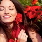Girl in poppies — Stock Photo #10795632