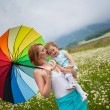 Mother with daughter on the meadow — Stock Photo #10817424