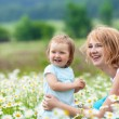 Mother with daughter on the meadow — Stock Photo #10817583