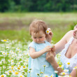 Mother with daughter on the meadow — Stock Photo #10817700