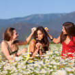 Three girls on camomile field — Stock Photo #10916031