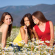 Three girls on camomile field — Stock Photo #10916073