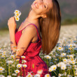 Foto de Stock  : Girl on camomile field