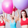 Three girls in fitnes club — Stock Photo