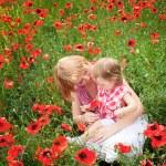 Family on the poppy field — Stock Photo #10949253