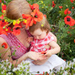 Family on the poppy field — Stock Photo #10949490