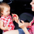 Mother with daughter in the car — Stock Photo