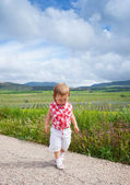 Child walking on the road — Stock Photo