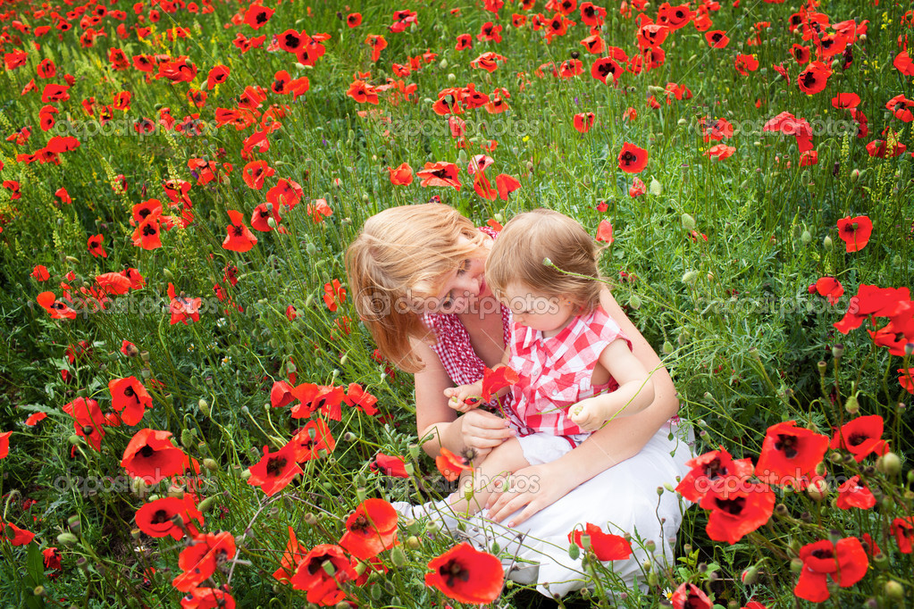 Mother with daughter on the poppy meadow — Stock Photo #10949253
