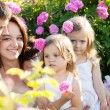 Family in rose flowers — Stock Photo #11011354