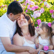 Family in rose flowers — Stock Photo