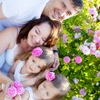 Family in rose flowers — Stock Photo #11011425