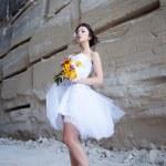 Bride near stone wall — Stock Photo #11011674