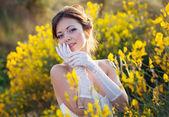 Bride outdoor portrait in flowers — Stock Photo