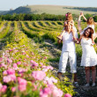 Family in rose flowers — Stock Photo #11092510