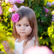 Girl in rose garden — Stock Photo