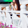 Girl with cocktail in cafe - Stock Photo