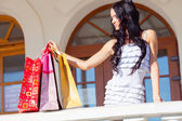 Woman with packages — Stock Photo