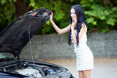 Woman near broken car — Stock Photo