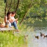 Family on the picnic near the lake — Stock Photo #11390506