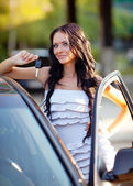 Girl near the car — Stock Photo