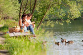 Family on the picnic near the lake — Stock Photo