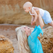 Mother with her baby on the beach — Stock Photo #11534451