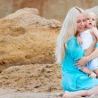 Mother with her baby on the beach — Stock Photo #11534473
