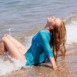 Girl sitting on the seashore - Foto de Stock  