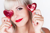 Blond girl with hearts — Stock Photo