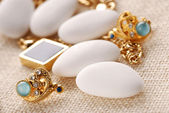 Jordan almonds and jewelry — Stock Photo