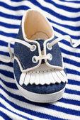 Blue baby shoe — Stock Photo