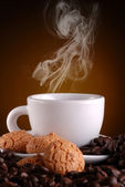 Steaming espresso coffee in white cup — Stock Photo