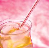 Cold fresh lemonade on pink background — Stock Photo