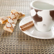 Royalty-Free Stock Photo: Coffee cup, cinnamon, sweets on the background