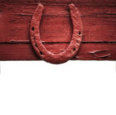 The old horseshoe hanging on wooden wall — Stock Photo