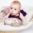 Infant drinking mother's milk, in the foreground sweet baby arm — Stock Photo