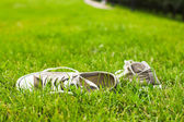 Shoes on the lawn — Stock Photo